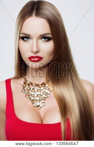 Close-up Portrait Of Beauty Girl With Long Hair. The Care Of Hair, Cosmetics For Hair. Bright Make-u