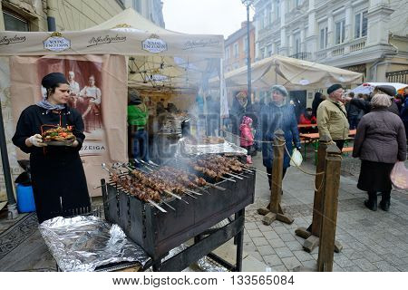 VILNIUS LITHUANIA - MARCH 7: Unidentified people trade food in annual traditional crafts fair - Kaziuko fair on Mar 7 2015 in Vilnius Lithuania