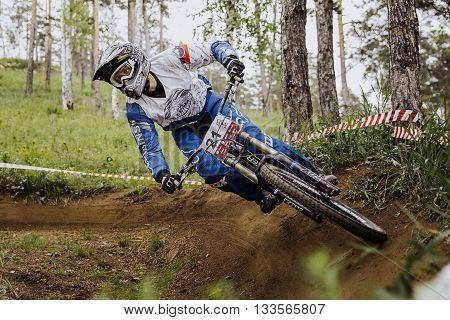 Miass Russia - May 29 2016: man athlete mountain biking around sharp turn during Cup