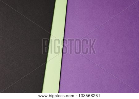 Colored cardboards background in purple green black tone. Copy space. Horizontal
