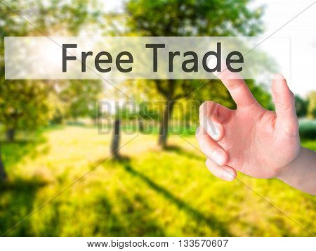 Free Trade - Hand Pressing A Button On Blurred Background Concept On Visual Screen.