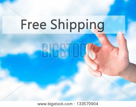 Free Shipping  - Hand Pressing A Button On Blurred Background Concept On Visual Screen.