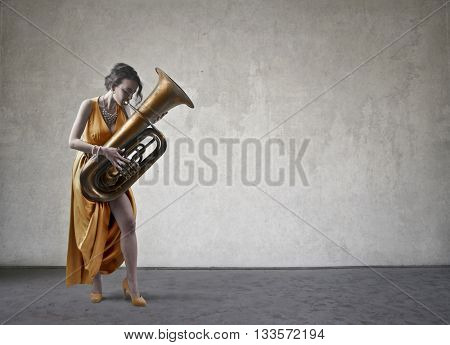 Classy lady playing an instrument