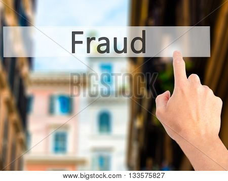 Fraud - Hand Pressing A Button On Blurred Background Concept On Visual Screen.