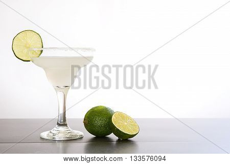 Margarita cocktail on slate table on white background