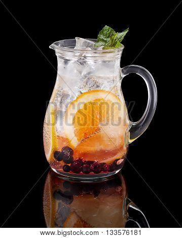 . Lemonade In The Jug With Orange And Mint Over Black Background