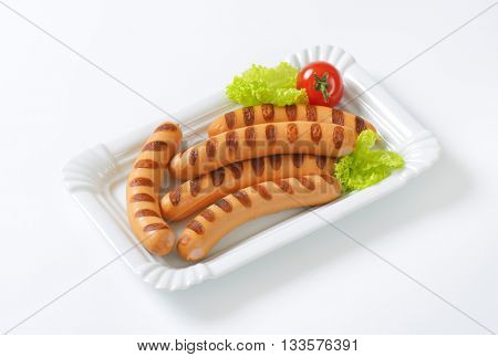 grilled wiener sausages on white plate