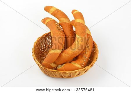 scuttle of fresh bread rolls on white background