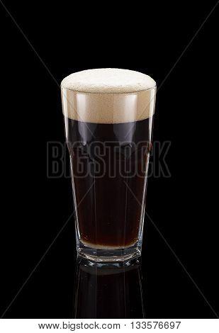 Glass Of Dark Beer Over Black Background