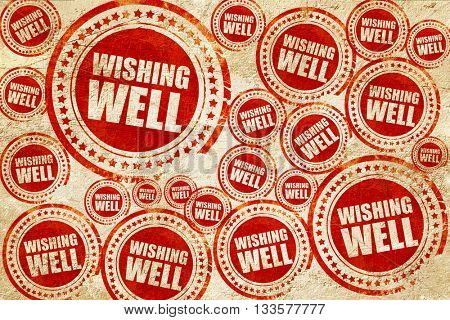 wishing well, red stamp on a grunge paper texture