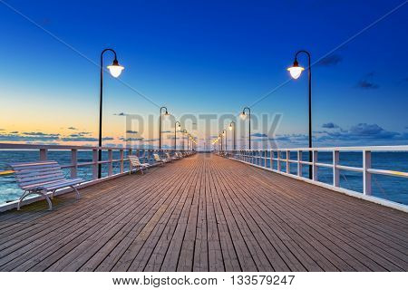 Wooden pier in Gdynia Orlowo at sunrise, Poland