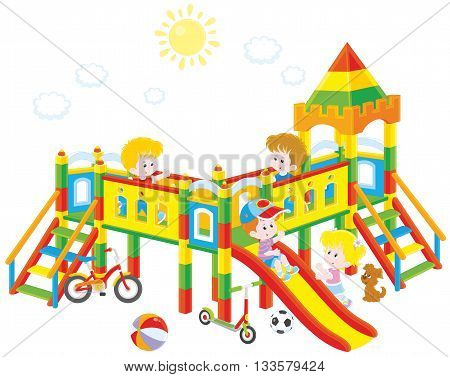 little children playing on a playground on a sunny summer day