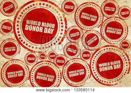 world blood donor day, red stamp on a grunge paper texture