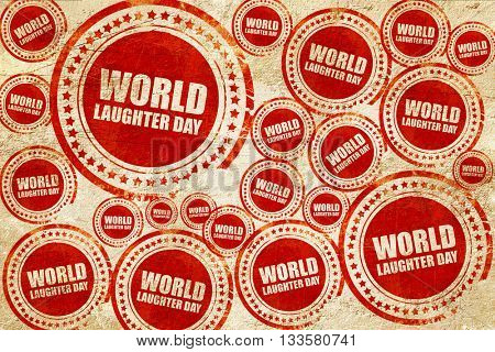 world laughter day, red stamp on a grunge paper texture