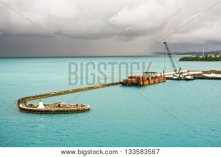 KINGS WHARF BERMUDA MAY 25 - Turquoise sea water and threatening skies over this pier in Kings Wharf on May 25 2016 in Bermuda.