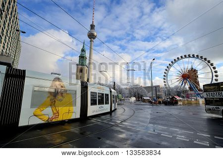 BERLIN - DECEMBER 26: traffic near Alexanderplatz on December 26 2014 in Berlin Germany. The tram in Berlin is one of the oldest tram systems in the world.
