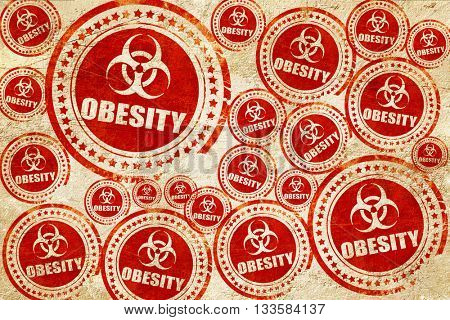 Obesity concept background, red stamp on a grunge paper texture
