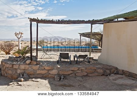 WUESTENQUELL, NAMIBIA-NOVEMBER 29, 2015: swimming pool on guest farm Wustenquell, Namibia