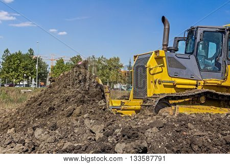 Detail on earthmover, while he moving ground.