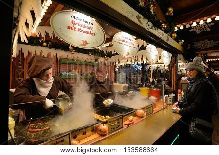 BERLIN - DECEMBER 26: Unidentified people trades food in annual traditional Christmas fair in Charlottenburg (Quarter of Berlin) on 26 December 2014 in Berlin Germany.