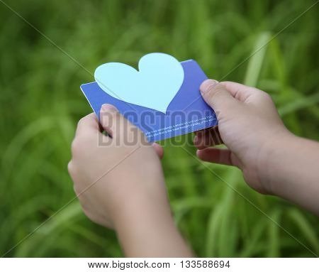 Children holding or showing card