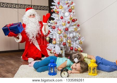 Santa Claus In New Years Eve Was Surprised Seeing The Tree Two Sleeping Children