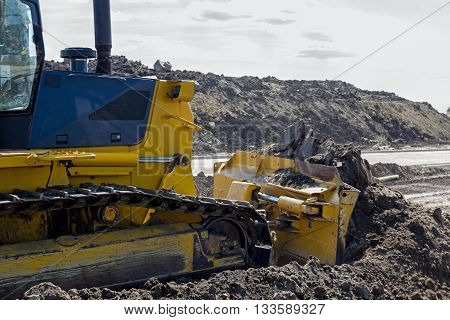 Detail on excavator while he moving ground.