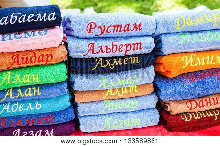 SAMARA RUSSIA - MAY 28 2016: Stack of the multicolored towels with embroidered Tatar names