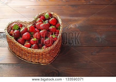 Very Beautiful Background With Fresh Strawberries In A Wicker Heart Shaped Wickerwork Basket On Old