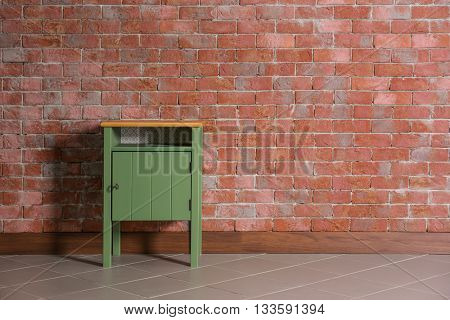 Bedside-table on brick wall background