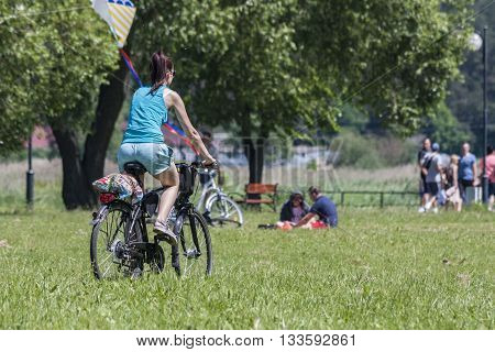 Bialystok Poland 5 June 2016. Cycling a young girl on a bike trip in the meadow