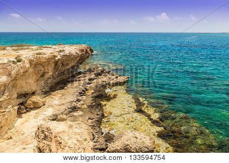 Seascape with rocks shore of the Mediterranean Sea. Coast of Cyprus Ayia Napa.