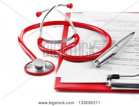 Red stethoscope and prescription on white background