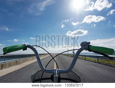 bicycle only handlebars straight ahead direction with blue sky background