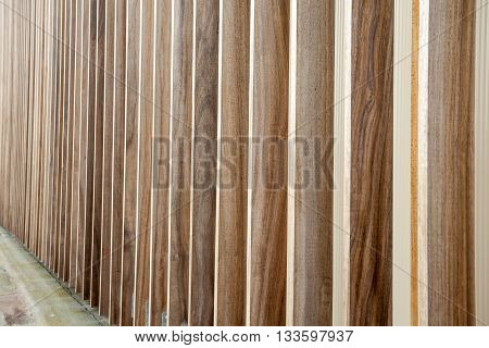 The wall is lined with unpainted wood