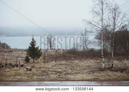 Cold Melancholic Spring Landscape with Lake .