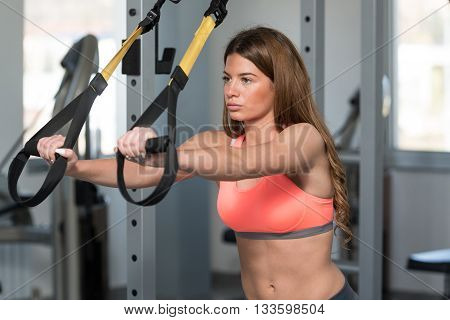 Young Attractive Woman Training With Trx Fitness Straps