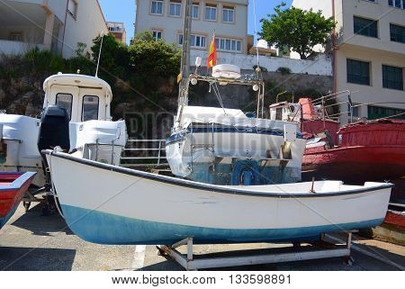 Colorful boats in a port of Galicia, Spain.