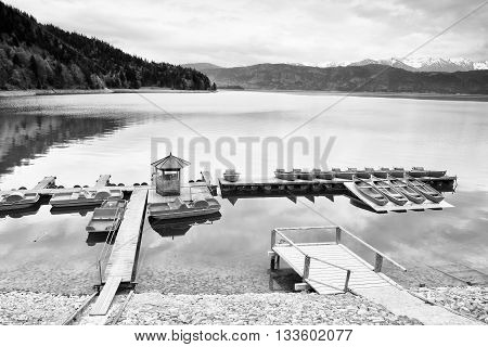 Empty Wooden Wharf Mole With Rental Rowing Boats