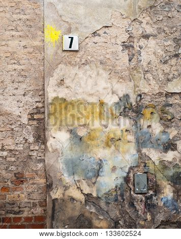 colorful abandoned brick wall and plate with a number seven