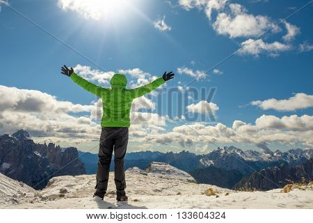 Woman hiker on a top of a mountain Dolomites Italy