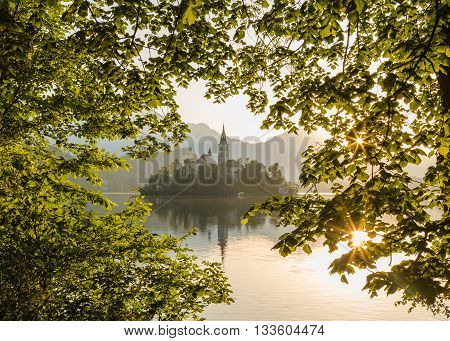 Church of the Assumption on Bled Lake in the morning at sunrise.