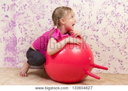 Cute Little Girl With Gymnastic Ball