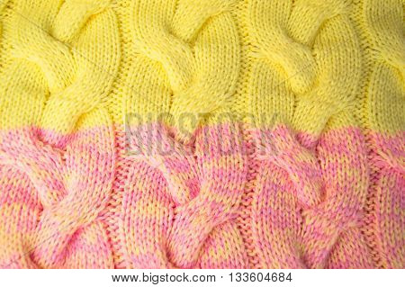 Pink and yellow knitted fabric background. Color image.