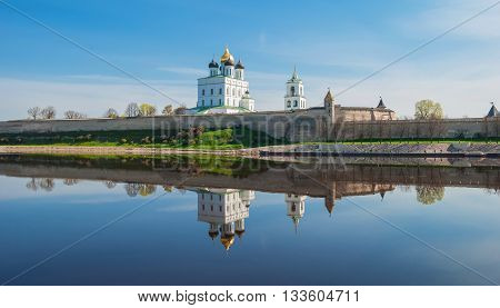 Pskov Kremlin and reflection in the river Great