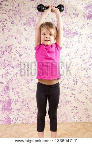 Cute Little Girl With Dump Bell