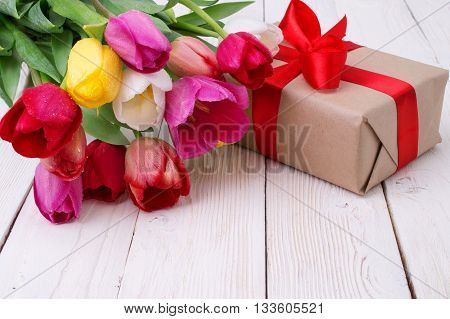 bouquet of colorful tulips on rustic wooden board, easter decoration