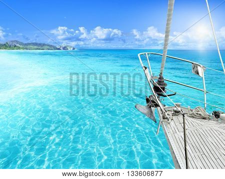 View of tropical beach from yacht.