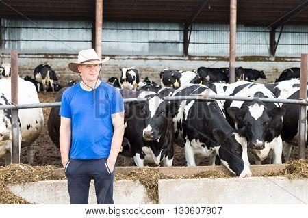 Portrait of a man Farmer on livestock cows farm.