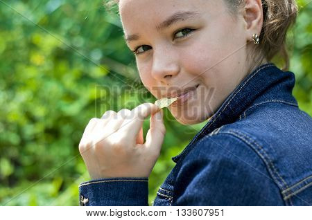 Girl with crisps turns around and smiling
